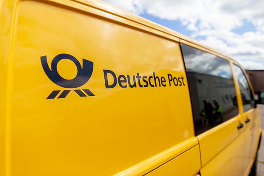 Altentreptow / Germany May 1, 2018: Transport vehicle Volkswagen T5 from Deutsche Post ( german post ) stands on a street.
