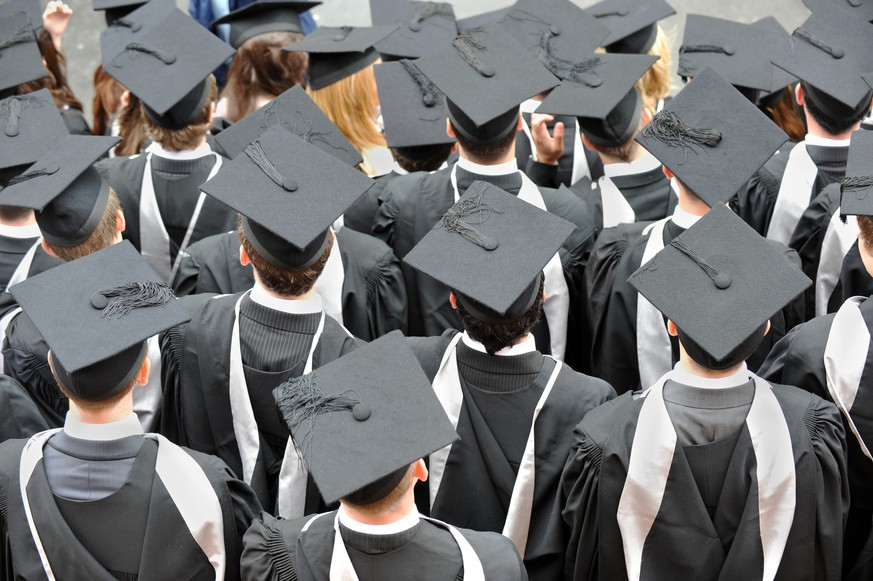 Birmingham, UK - July 14, 2010: Graduate college students photographed from above wearing traditional mortar board hats and robes at their degree ceremony in Birmingham University