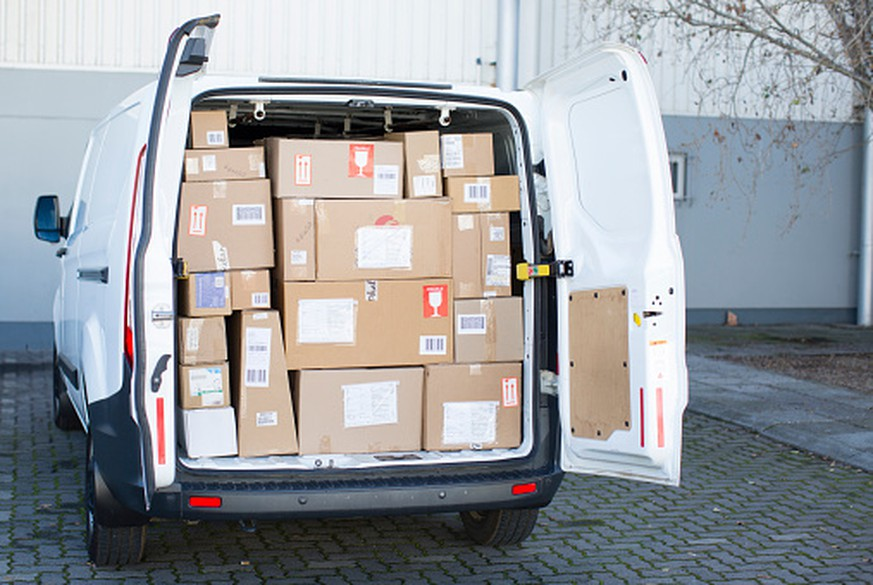 Courier van full of parcels and boxes
