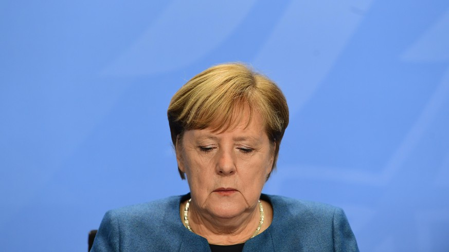 BERLIN, GERMANY - OCTOBER 28: German Chancellor, Angela Merkel attends a press conference after a video conference with German State Premiers about the current coronavirus situation, at the Chancellery on October 28, 2020 in Berlin, Germany. (Photo by Filip Singer - Pool/Getty Images)