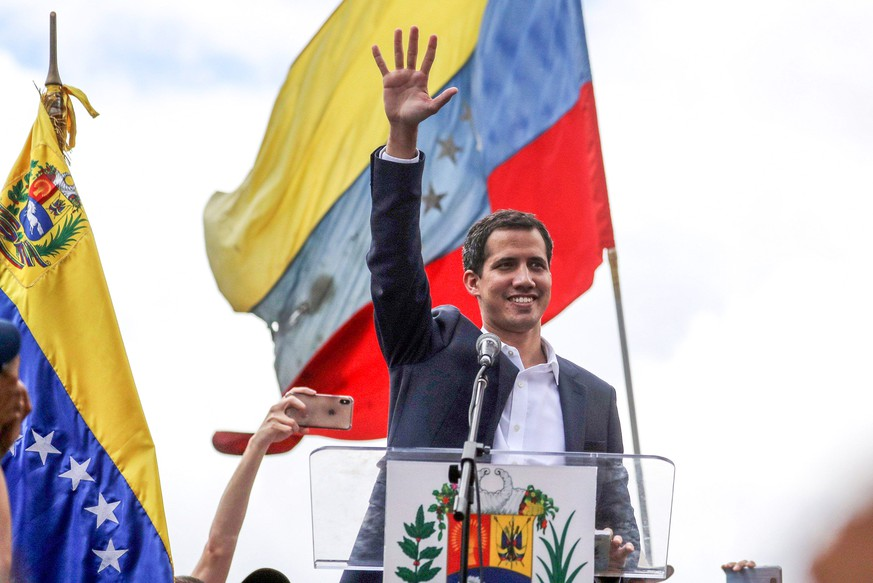 Juan Guaido, President of the Venezuelan Parliament, speaks to supporters as he announces that he assumes executive powers, in Caracas, Venezuela, 23 January 2019. Guaido declared himself interim president of Venezuela - a move that was quickly recognised by US President Trump - in fight against President Maduro whose presidency Guaido considers illegitimate . The USA and South American countries have been pressing for Maduro s ouster more strongly in the past weeks, aimed to end his presidency after years of crisis. Guaido declares himself Venzuelan interim president !ACHTUNG: NUR REDAKTIONELLE NUTZUNG! PUBLICATIONxINxGERxSUIxAUTxONLY Copyright: xMiguelxGutiérrezx AME1403 20190123-636838722267729728