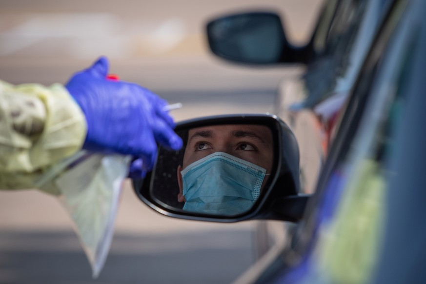 A man prepares to be tested at a coronavirus disease (COVID-19) drive-in testing location in Houston, Texas, U.S., August 18, 2020.   REUTERS/Adrees Latif