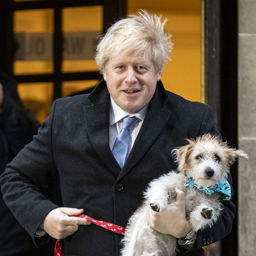December 12, 2019, London, England, UK: British Prime Minister BORIS JOHNSON with DILYN the dog at Methodist Central Hall to cast his vote in the 2019 General Election. Johnson is on course to secure a huge Tory majority in the Commons, according to the exit poll. (Credit Image: © Rob Pinney/London News Pictures via ZUMA Wire |
