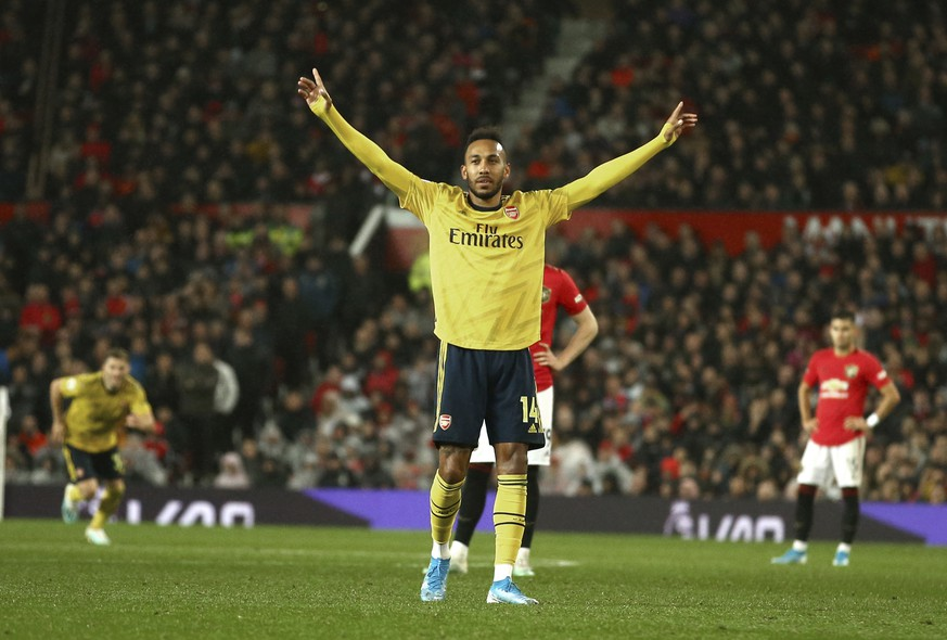 Arsenal's Pierre-Emerick Aubameyang celebrates after scoring the opening goal during the English Premier League soccer match between Manchester United and Arsenal at Old Trafford in Manchester, England, Monday, Sept. 30, 2019. (AP Photo/Dave Thompson)