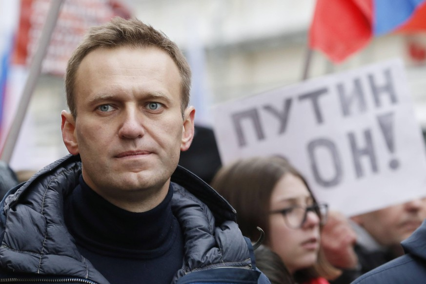 MOSCOW, RUSSIA - FEBRUARY 24, 2019: Opposition activist Alexei Navalny takes part in the 4th annual rally to mark the 4th anniversary of the assassination of opposition politician Boris Nemtsov in central Moscow. Sergei Karpukhin/TASS PUBLICATIONxINxGERxAUTxONLY TS0A22B7
