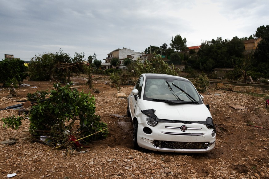 A car on a destroyed crop after flooding in Sant Llorenc, 60 kilometers (40 miles) east of Mallorca's capital, Palma, Spain, Wednesday, Oct. 10, 2018. Torrential rainstorms that caused flash flooding of water and mud on the Spanish island of Mallorca killed at least nine people, authorities said on Wednesday. (AP Photo/Francisco Ubilla)