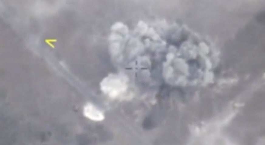 A still image taken from a video footage and released by Russia's Defence Ministry on September 5, 2018, shows a missile hitting a target, which Defence Ministry said was a terrorists' position in Idlib province, Syria September 4, 2018. Russian Defence Ministry/Handout via REUTERS TV  ATTENTION EDITORS - THIS PICTURE WAS PROVIDED BY A THIRD PARTY. NO RESALES. NO ARCHIVE.