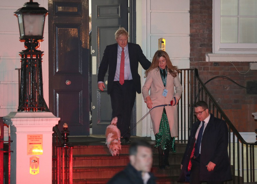 General Election 2019. Prime Minister Boris Johnson leaving Conservative Party Headquarters, with with partner Carrie Symonds and dog Dilyn in central London as his party romped to victory in the 2019 General Election. Picture date: Friday December 13, 2019. See PA story POLITICS Election. Photo credit should read: Andrew Matthews/PA Wire URN:48991452 |