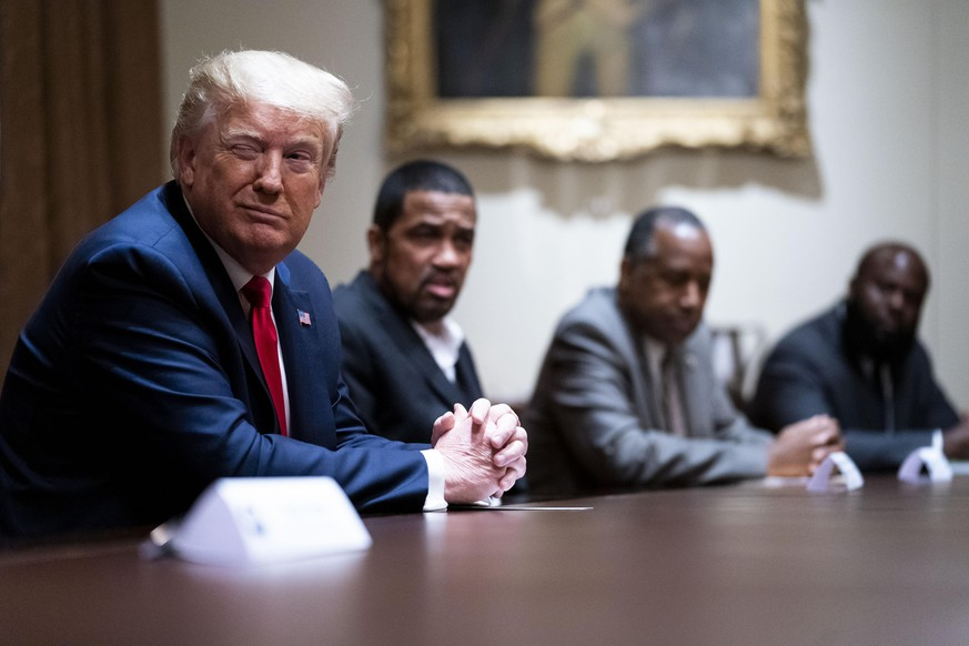 WASHINGTON, DC - JUNE 10: U.S. President Donald Trump winks during a round table discussion with African American supporters in the Cabinet Room of the White House on June 10, 2020 in Washington, DC. (Photo by Doug Mills-Pool/Getty Images)