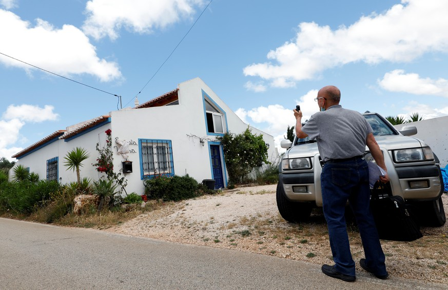 A reporter takes a picture of the house where the suspect lived when three-year-old Madeleine McCann disappeared in 2007, near Lagos, Portugal, June 4, 2020. REUTERS/Rafael Marchante