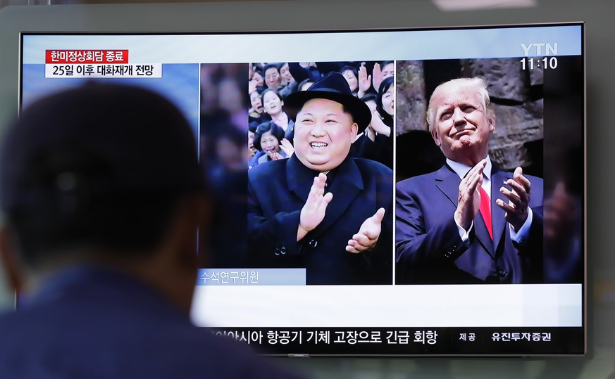 A man watches a TV screen showing file footage of U.S. President Donald Trump, right, and North Korean leader Kim Jong Un, left, during a news program at the Seoul Railway Station in Seoul, South Korea, Wednesday, May 23, 2018. North Korea on Wednesday allowed South Korean journalists to join the small group of foreign media in the country to witness the dismantling of its nuclear test site this week, Seoul officials said. (AP Photo/Lee Jin-man)