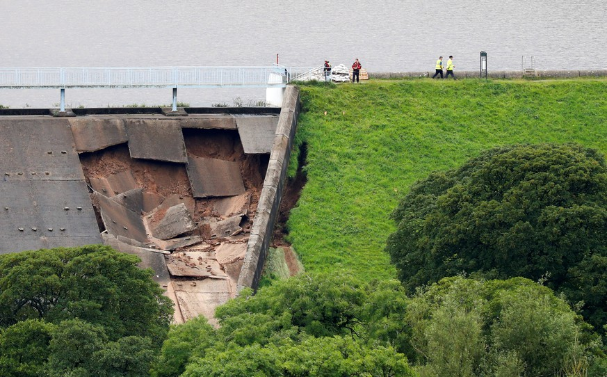 The damage of a dam is seen after a nearby reservoir was affected by flooding, in Whaley Bridge, Britain August 1, 2019. REUTERS/Phil Noble