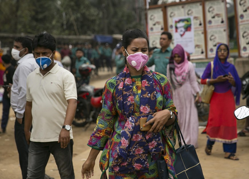 DHAKA, BANGLADESH - MARCH 08: A woman wears a face mask amid a global coronavirus outbreak at a Women's Day rally March 8, 2020 in Dhaka, Bangladesh. International Women's Day is observed on March 8 every year, celebrating the achievements of women around the world. (Photo by Allison Joyce/Getty Images)