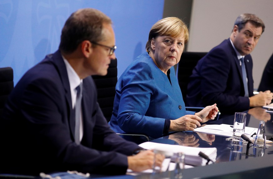 German Chancellor Angela Merkel, Bavarian Prime Minister Markus Soeder and Berlin's mayor Michael Mueller attend a news conference at the Chancellery in Berlin, Germany October 28, 2020. REUTERS/Fabrizio Bensch/Pool