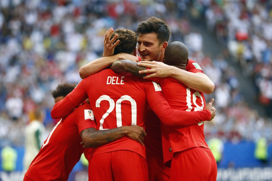 England's Dele Alli, left, celebrates with England's Harry Maguire, center and England's Marcus Rashford, right, after scoring his side's second goal during the quarterfinal match between Sweden and England at the 2018 soccer World Cup in the Samara Arena, in Samara, Russia, Saturday, July 7, 2018. (AP Photo/Matthias Schrader )
