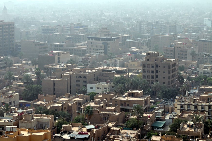 This skyline of downtown Baghdad with rooftops and terraces is a very typical urban view seen all over the Middle East.