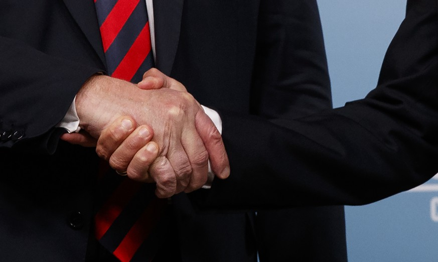 President Donald Trump, left, shakes hands with French President Emmanuel Macron during the G-7 summit, Friday, June 8, 2018, in Charlevoix, Canada. (AP Photo/Evan Vucci)