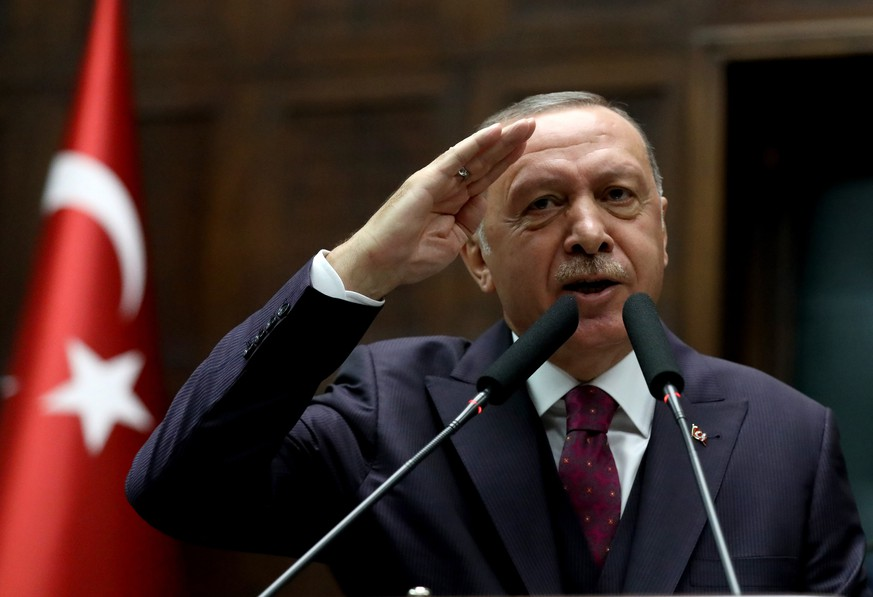 Turkish President Recep Tayyip Erdogan gives a military salute toward cheering supporters his ruling party legislators at the Parliament, in Ankara, Wednesday, Oct 30, 2019.  PUBLICATIONxINxGERxSUIxAUTxHUNxONLY Copyright: DepoxPhotos 16542848