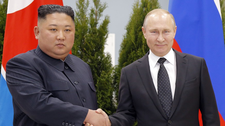 Russian President Vladimir Putin, right, and North Korea's leader Kim Jong Un shake hands during their meeting in Vladivostok, Russia, Thursday, April 25, 2019. Putin opened his talks with Kim, saying that Russia would like to help support efforts to resolve the North Korean nuclear standoff. (AP Photo/Alexander Zemlianichenko, Pool)