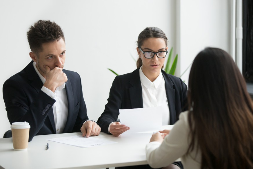 Concerned thoughtful hr managers listen to applicant, focused recruiters look doubtful uncertain about hiring incompetent candidate, bad first impression or failed job interview performance concept