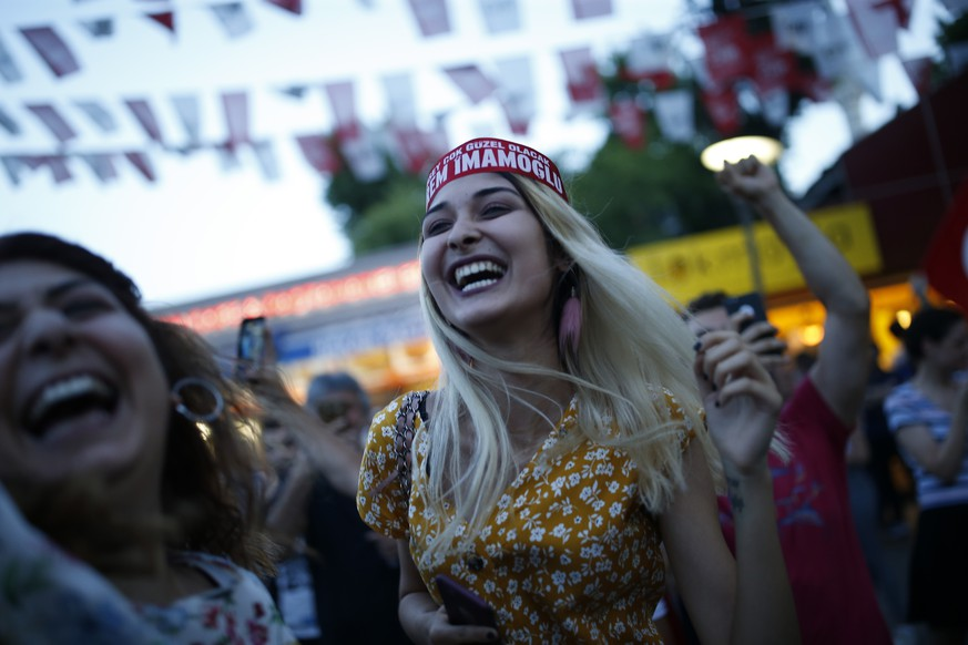 Supporters of Ekrem Imamoglu candidate of the secular opposition Republican People's Party celebrate in Istanbul, Sunday, June 23, 2019. In a blow to Turkish President Recep Tayyip Erdogan, an opposition candidate declared victory in the Istanbul mayor's race for a second time Sunday after the government-backed candidate conceded defeat in a high-stakes repeat election. (AP Photo/Emrah Gurel)