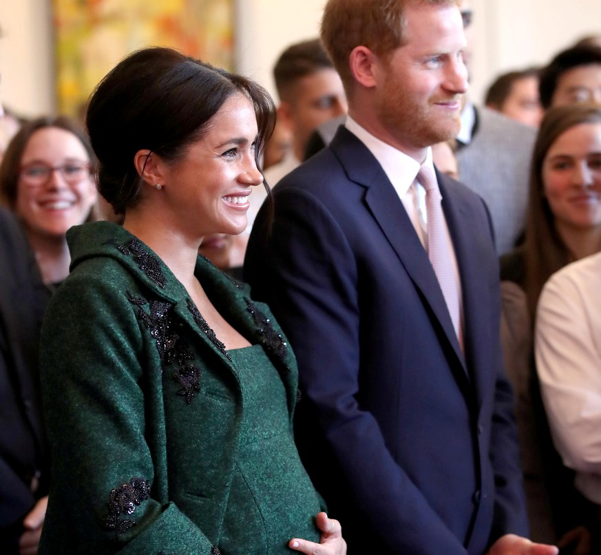 FILE PHOTO: Britain's Prince Harry and Meghan, Duchess of Sussex attend a Commonwealth Day youth event at Canada House in London, Britain, March 11, 2019. Chris Jackson/Pool via REUTERS/File Photo