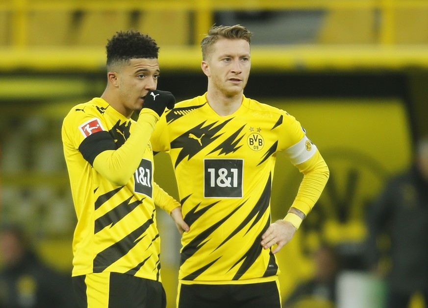 Soccer Football - Bundesliga - Borussia Dortmund v FC Cologne - Signal Iduna Park, Dortmund, Germany - November 28, 2020 Borussia Dortmund's Jadon Sancho with Marco Reus during the match Pool via REUTERS/Leon Kuegeler DFL regulations prohibit any use of photographs as image sequences and/or quasi-video.