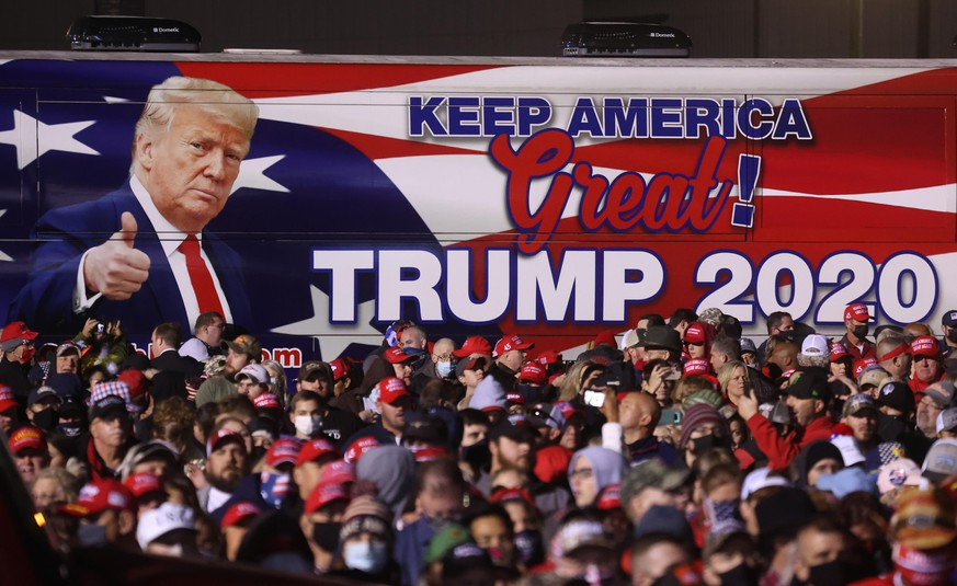 ROME, GEORGIA - NOVEMBER 01: A bus with an image of U.S. President Donald Trump sits next to the crowd during a campaign rally at Richard B. Russell Airport on November 01, 2020 in Rome, Georgia. With two days to go until election day, Donald Trump is campaigning in Michigan, Iowa, North Carolina, Georgia and Florida. (Photo by Justin Sullivan/Getty Images) (Photo by Justin Sullivan/Getty Images)