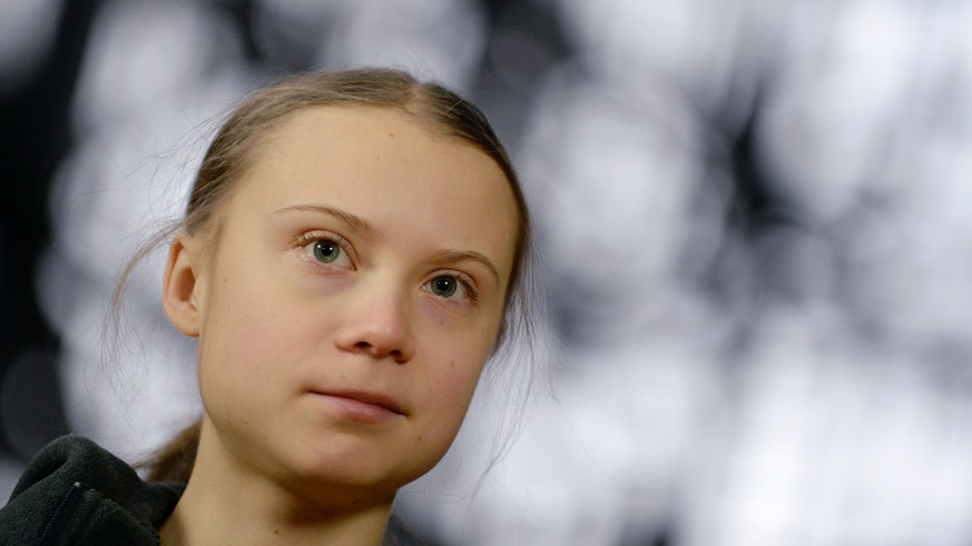 FILE PHOTO: Swedish climate activist Greta Thunberg talks to the media before meeting with EU environment ministers in Brussels, Belgium, March 5, 2020. REUTERS/Johanna Geron/File Photo