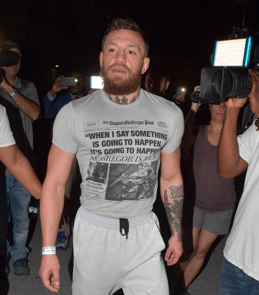 "MIAMI, FLORIDA - MARCH 11: Former UFC champ Conor McGregor was charged with strong-armed robbery and criminal mischief, both felonies. After an altercation with a fan early Monday morning, according to the Miami Beach police. Seen here wearing sandals, sweats and a t-shirt that says, When I say something is going to happen it s going to happen McGregor is back"" McGregor was released from jail at the Turner Guilford Knight Correctional Center on $12,500 bal and than jumped in a black SUV and was driven back to his Miami Beach Mansion on March 11, 2019 in Miami, Florida..People: Conor McGregor. Conor McGregor arrested in Miami Beach, accused of smashing fan s phone PUBLICATIONxINxGERxSUIxAUTxONLY - ZUMAs214 90042967st Copyright: xSMGx"