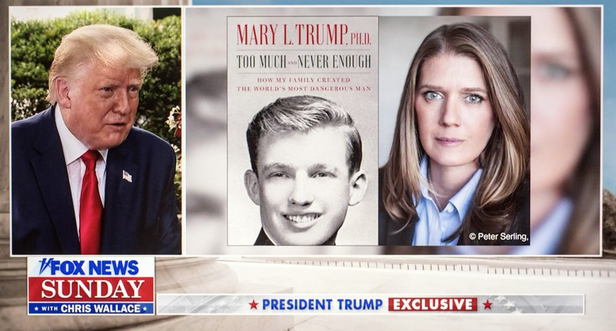July 19, 2020 - Washington, District of Columbia, U.S. - A video capture of President DONALD TRUMP being interviewed by CHRIS WALLACE for Fox News Sunday. Pictured: a split screen of Trump and the book, Too Much and Never Enough, written by his niece, MARY TRUMP. Washington U.S. - ZUMAce6_ 20200719_zaf_ce6_018 Copyright: xBrianxCahnx